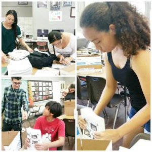 Pinion staffers from 2017 bundle copies of the paper to give out to students 和 staff.